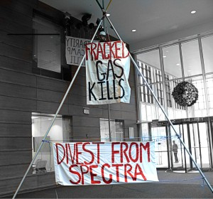 An activist set up a 24 foot tall tripod in a Spectra office - with a clear message for investors.